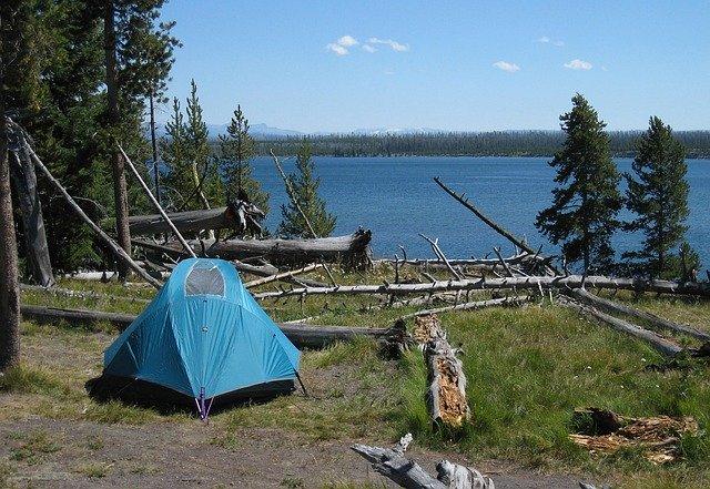 tent camping lake trees