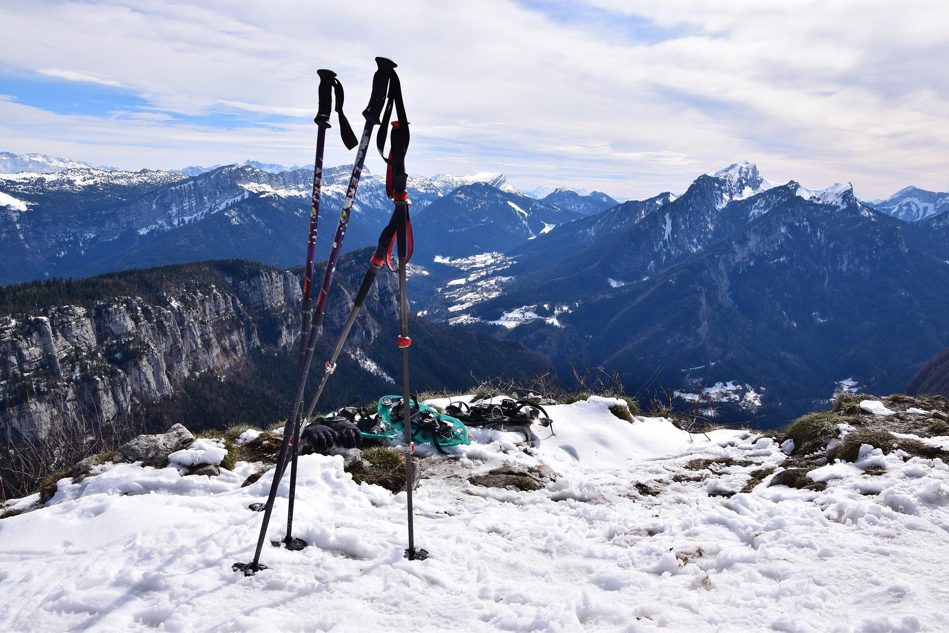 snowshoeing poles snow mountains pixabay