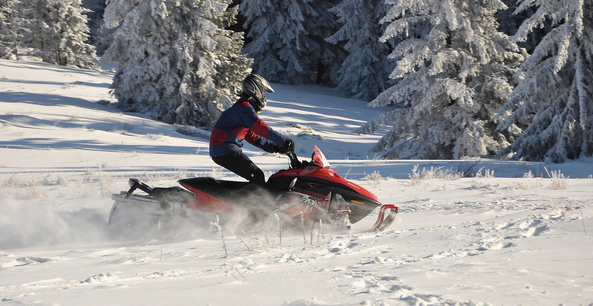 snowmobiling snow winter pixabay